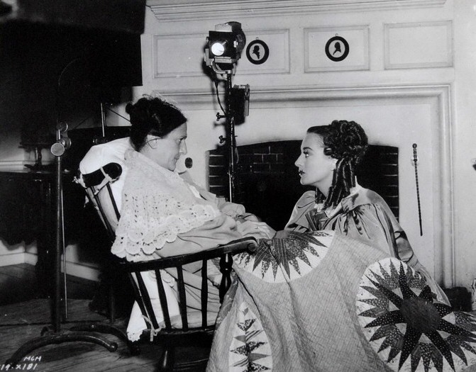 1936. On the 'Gorgeous Hussy' set with co-star Beulah Bondi.