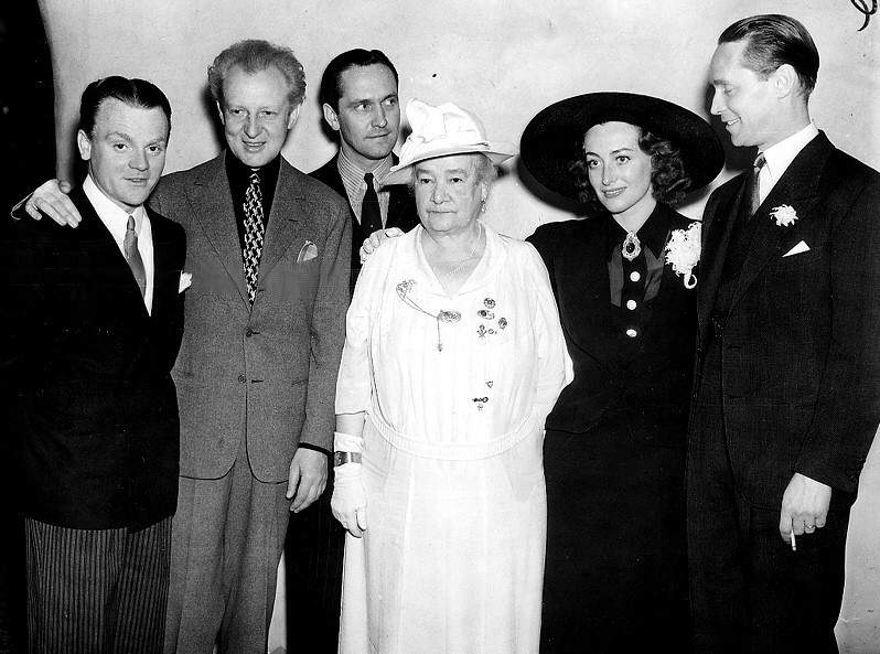 March 10, 1936. Reception for conductor Leopold Stokowski at LA's Ambassador Hotel. From left: James Cagney, Stokowski, Fredric March, unknown, Joan, Franchot Tone.