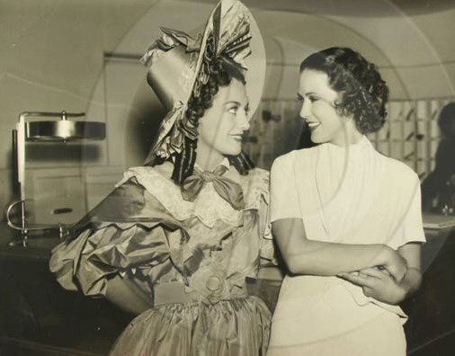 1936. On the set of 'Gorgeous Hussy' with Eleanor Powell.