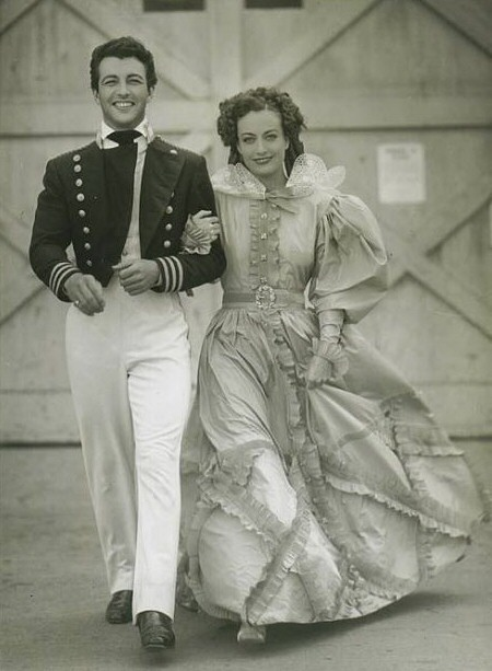 1936. On the set of 'Gorgeous Hussy,' with Robert Taylor. (Thanks to Shane.)