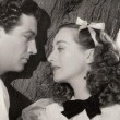With Robert Taylor.