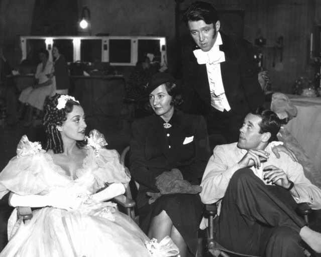 1936. On the set of 'Gorgeous Hussy' with Barbara Stanwyck, James Stewart, and Henry Fonda.