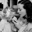 1936. On the set of 'Gorgeous Hussy' with niece Joan LeSueur.
