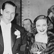 1936. With husband Franchot Tone at unknown event.