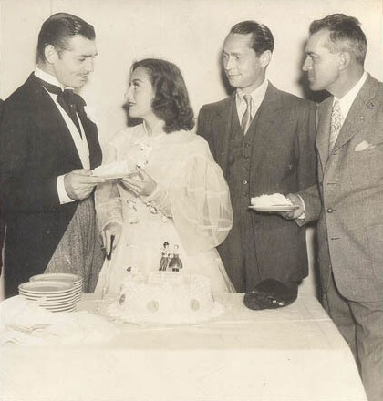 1936. On the set of 'Love on the Run' with Gable, Franchot Tone, and director W.S. Van Dyke.
