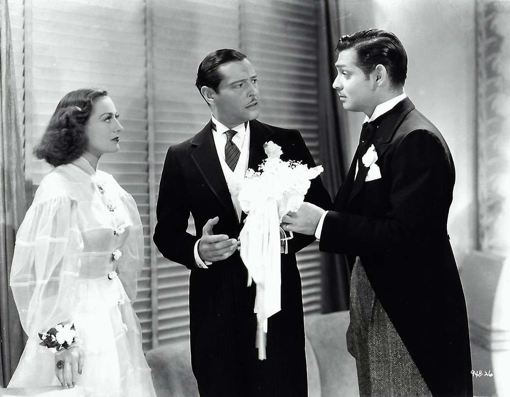 1936. 'Love on the Run.' With Clark Gable, right.
