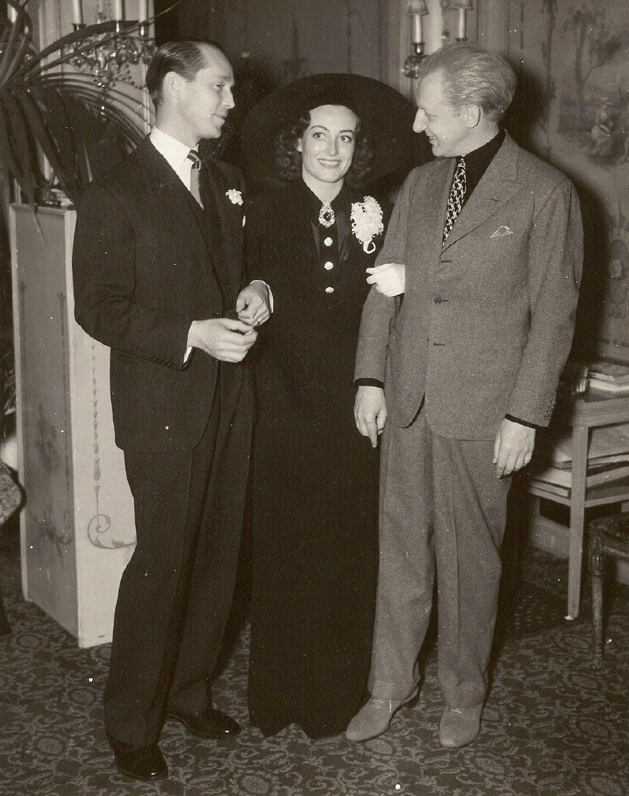 March 1936 at LA's Ambassador Hotel with Franchot Tone and conductor Leopold Stokowski.
