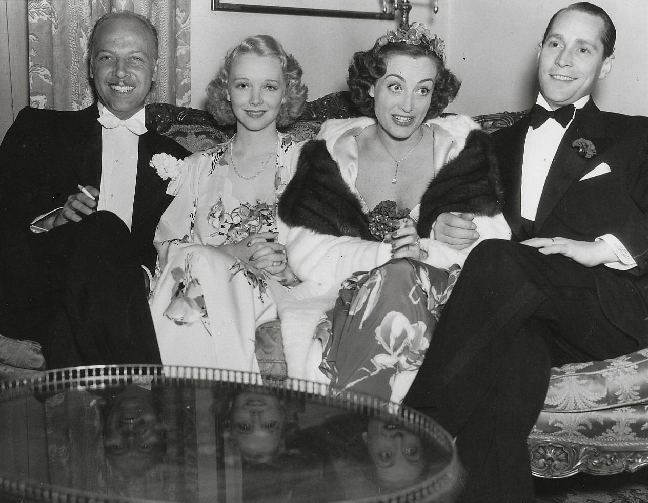 April 19, 1936. At the Beverly Wilshire Mayfair Ball, with Mitchell Leisen, Virginia Bruce, and Franchot Tone.