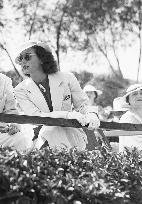 July 1936 at a polo match with Barbara Stanwyck and Franchot Tone.
