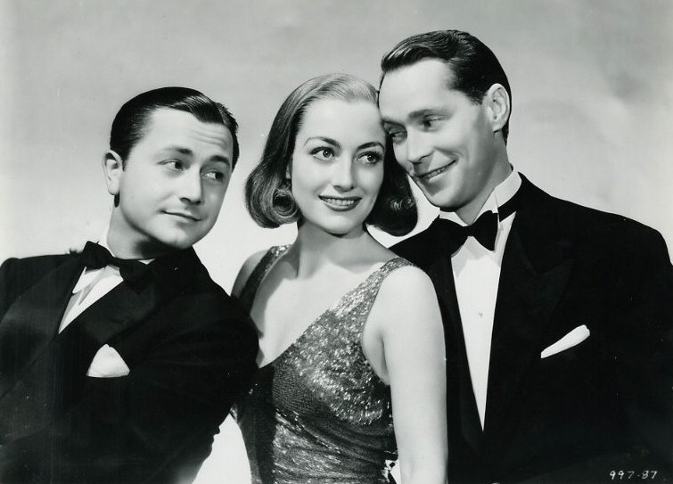1937. 'The Bride Wore Red' publicity. With Robert Young and Franchot Tone.