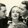 1937. Publicity for 'The Bride Wore Red,' with Robert Young, left, and husband Franchot Tone.