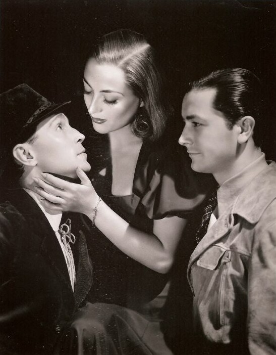 1937. 'The Bride Wore Red.' With Franchot Tone, left, and Robert Young.