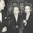1937. With Franchot Tone, left, and Sally Blane.