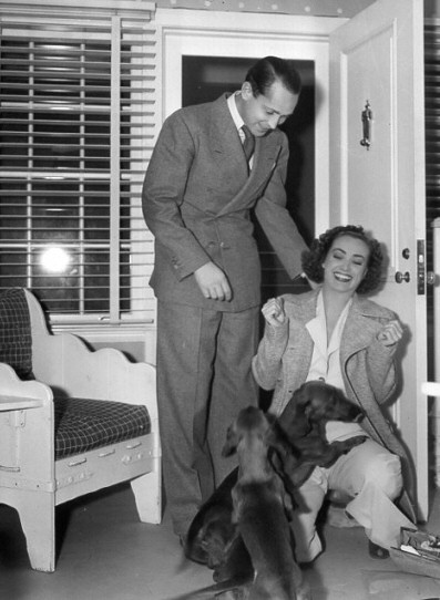1937. In her dressing room with Franchot Tone on the set of 'The Last of Mrs. Cheyney.'