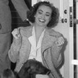 1937. In her dressing room with pups and Franchot.