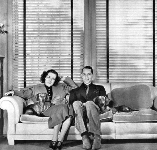 1936. At home with husband Franchot Tone and pups Baby and Bubchen.