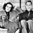 1936. At home with husband Franchot Tone and dachshunds Baby and Bubchen.