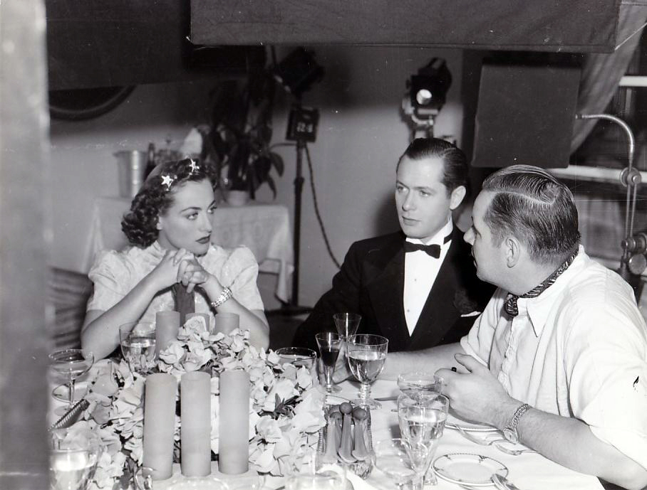 1937. On the set of 'The Last of Mrs. Cheyney' with Robert Montgomery and director Boleslawski.