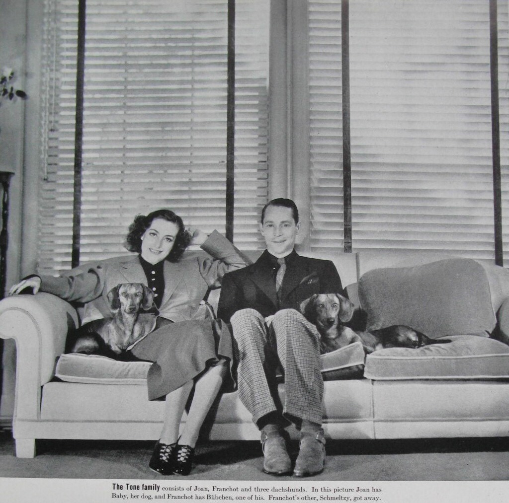 1936. At home with Franchot and pups Baby and Bubchen. (From 'Life,' March 1, 1937.)