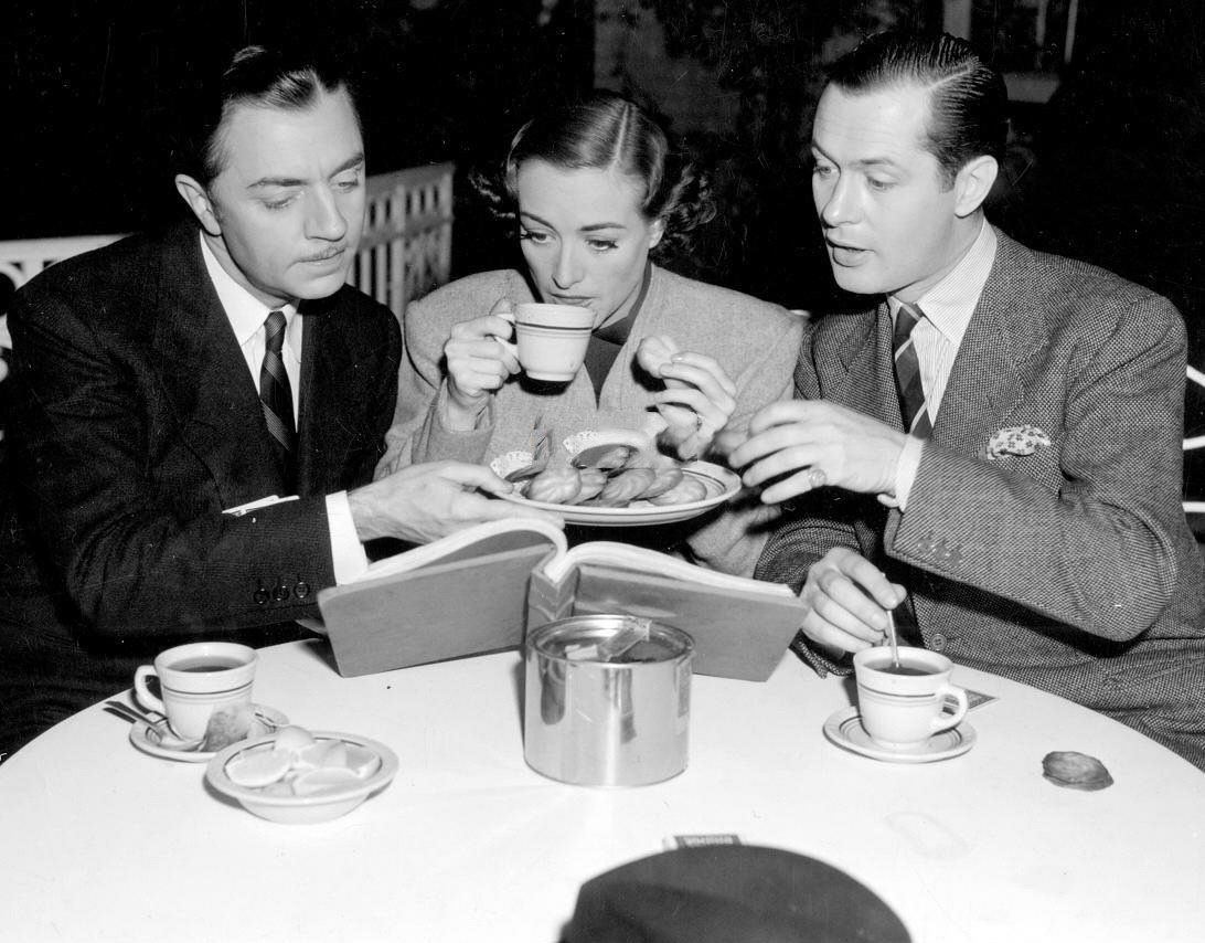 1937. On the set of 'The Last of Mrs. Cheynyey' with William Powell, left, and Robert Montgomery.