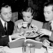 1937. On the set of 'The Last of Mrs. Cheyney' with William Powell, left, and Robert Montgomery.