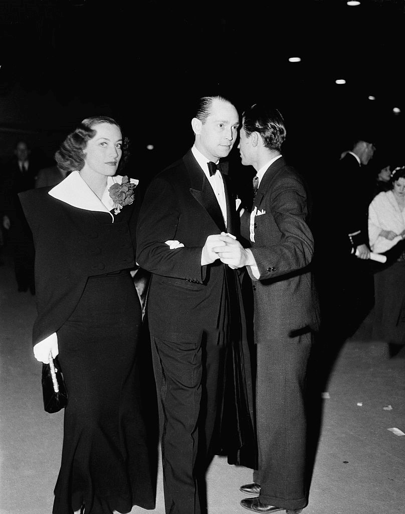 1936. With husband Franchot Tone and unknown.