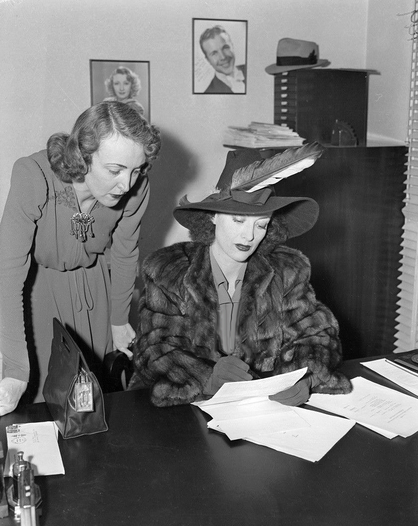 March 1939. Signing divorce papers.
