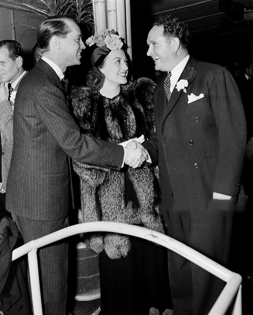 1937. With husband Franchot Tone, left, and director Frank Borzage.
