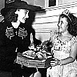 1938. Joan visits Shirley Temple on the set of 'Little Miss Broadway.'