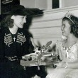 1938. On the set of 'Little Miss Broadway' with Shirley Temple.