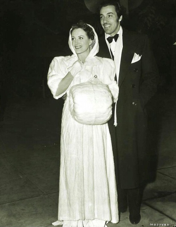 January 1940. At the Hollywood premiere of 'Gone With the Wind,' with Cesar Romero.