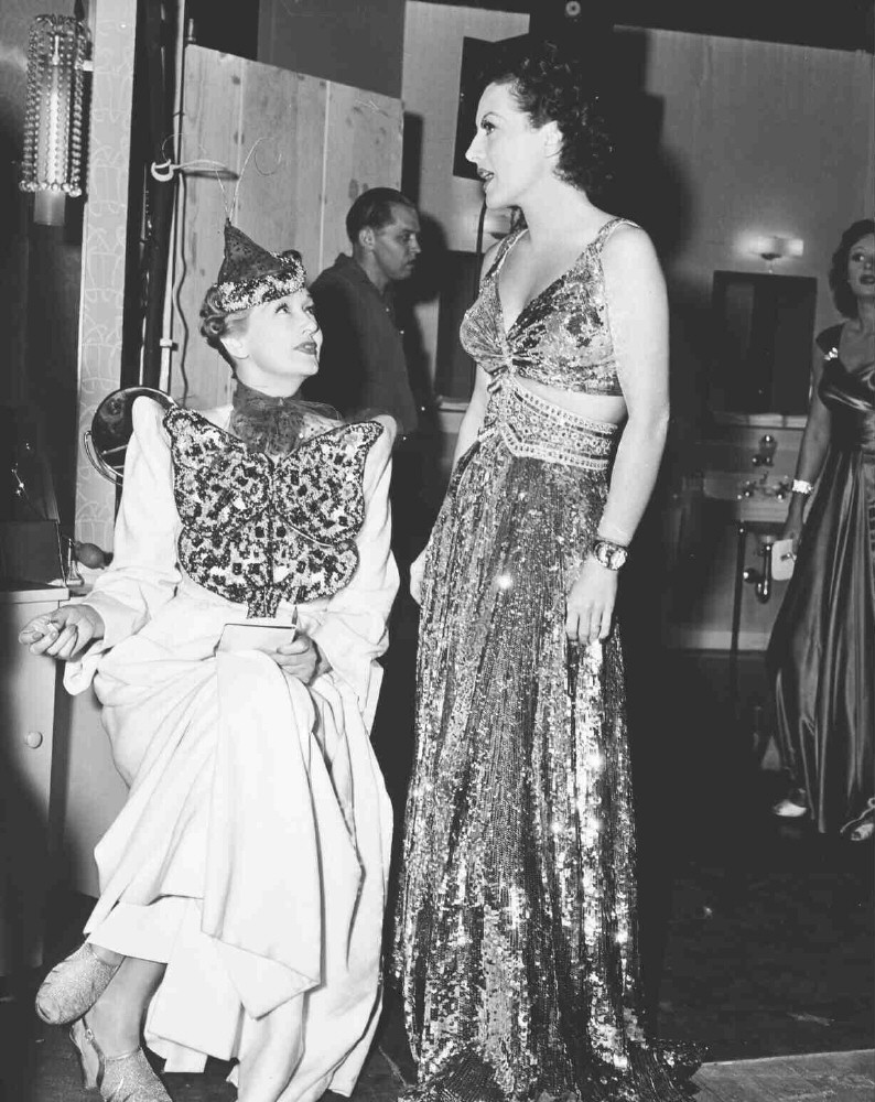 1939. On the set of 'The Women' with Hedda Hopper.