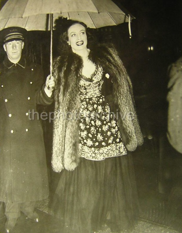 March 27, 1939. Arriving at a NYC club to meet soon-to-be ex Franchot Tone.