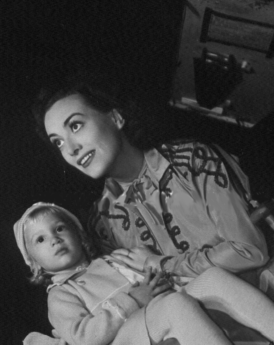1937. On the set of 'The Last of Mrs. Cheyney' with niece Joanie LeSueur.