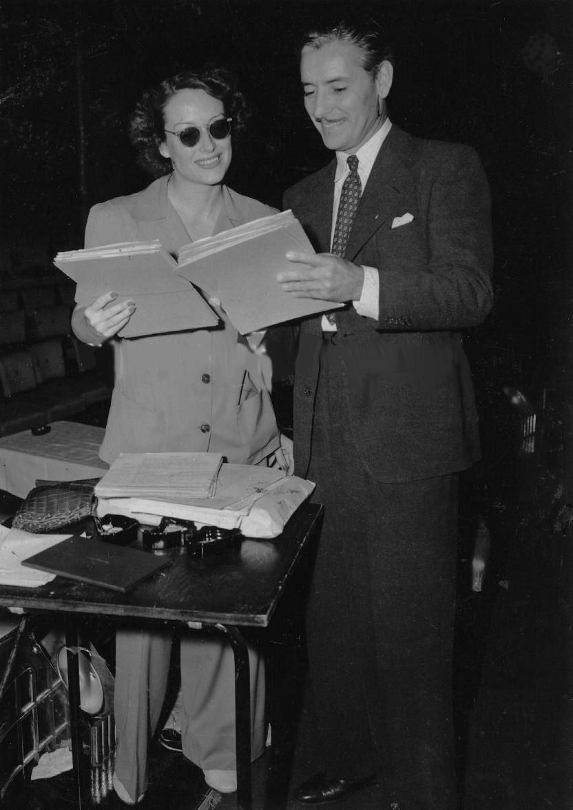 1939. With Ronald Colman on the set of a radio show.