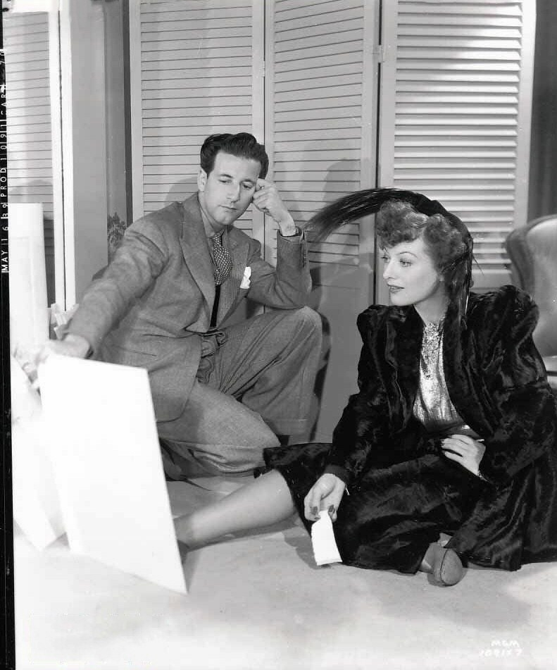 May 16, 1939. On the set of 'The Women' with designer Adrian.