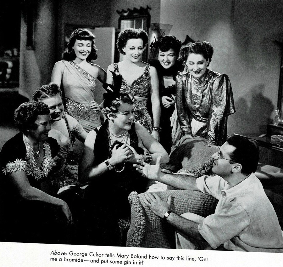 1939. On the set of 'The Women' with cast and director George Cukor.
