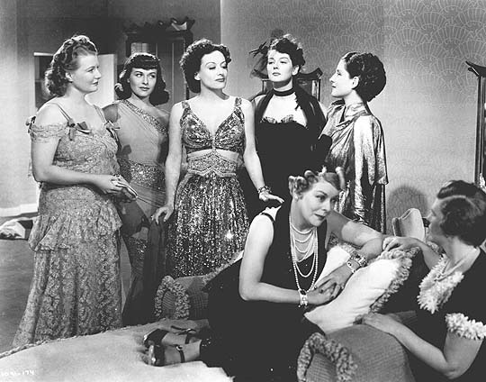 With Phyllis Povah, Paulette Goddard, Ros Russell, Mary Boland, and Norma Shearer.
