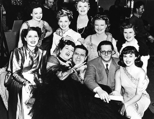 1939. On the set of 'The Women' with cast, director Cukor, and producer Hunt Stromberg.