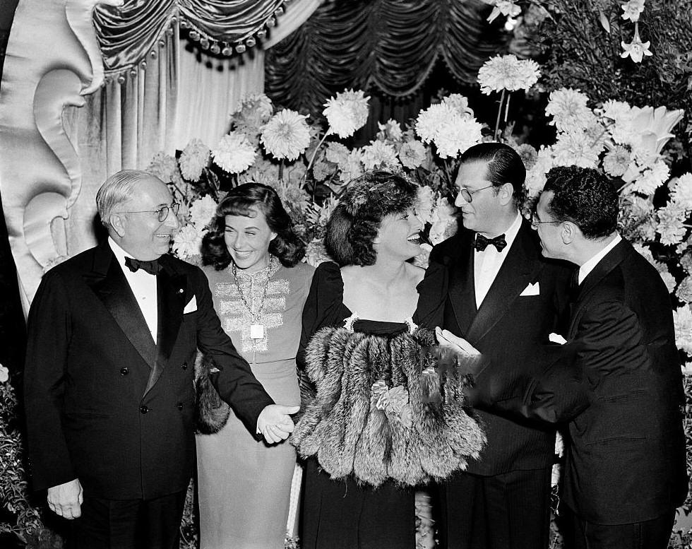1939. At the premiere of 'The Women' with LB Mayer, Paulette Goddard, Hunt Stromberg, and George Cukor.