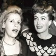 1945. Warners reception for Joan at NYC's Sherry-Netherland hotel, with Radie Harris.