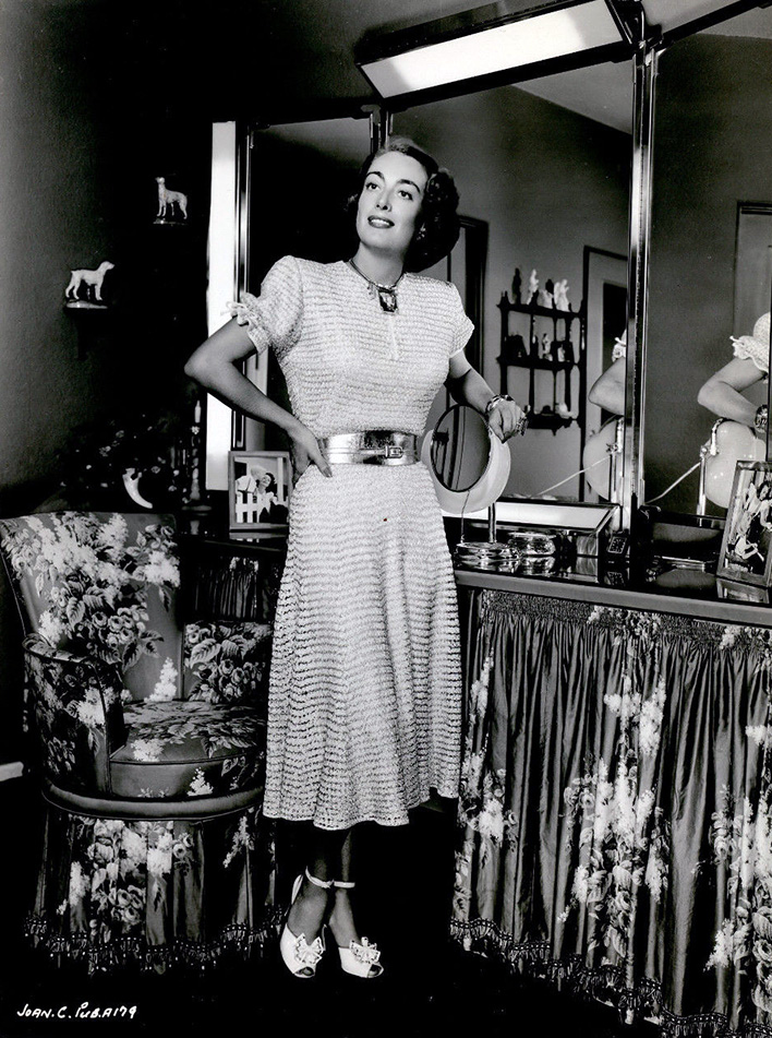 1949 publicity in a dress Joan knitted herself.