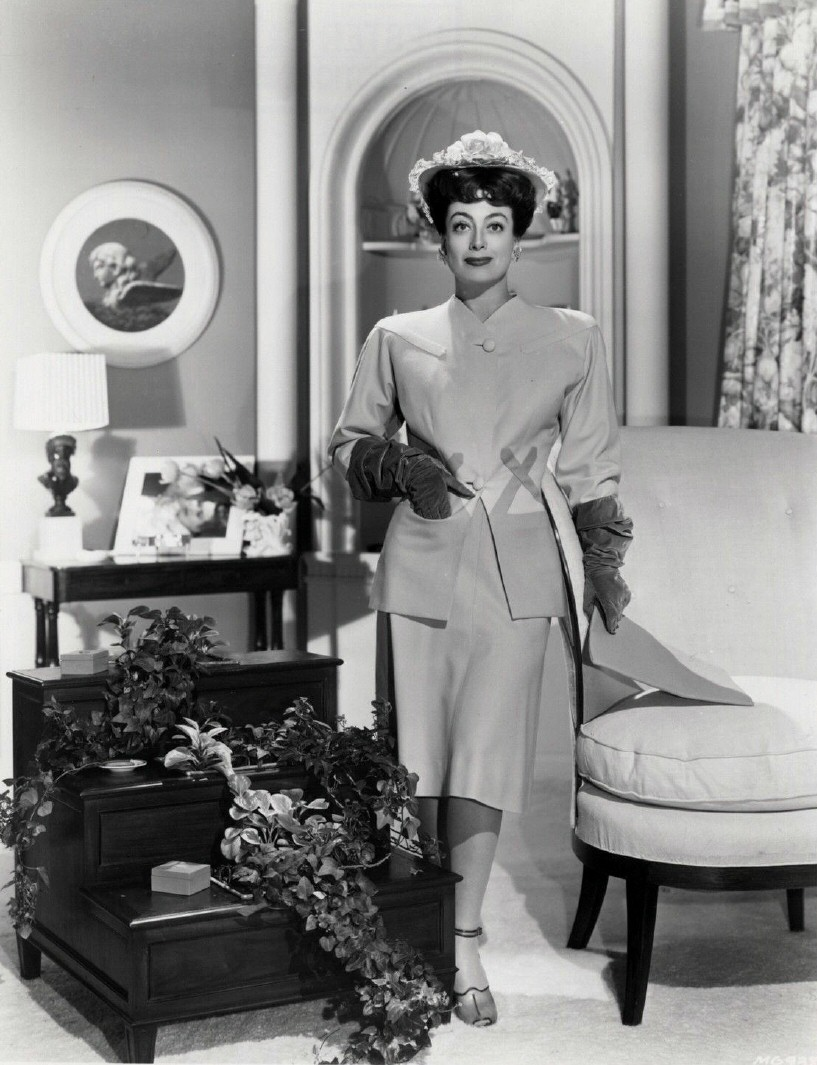 1942. Joan in her wedding suit by Irene.