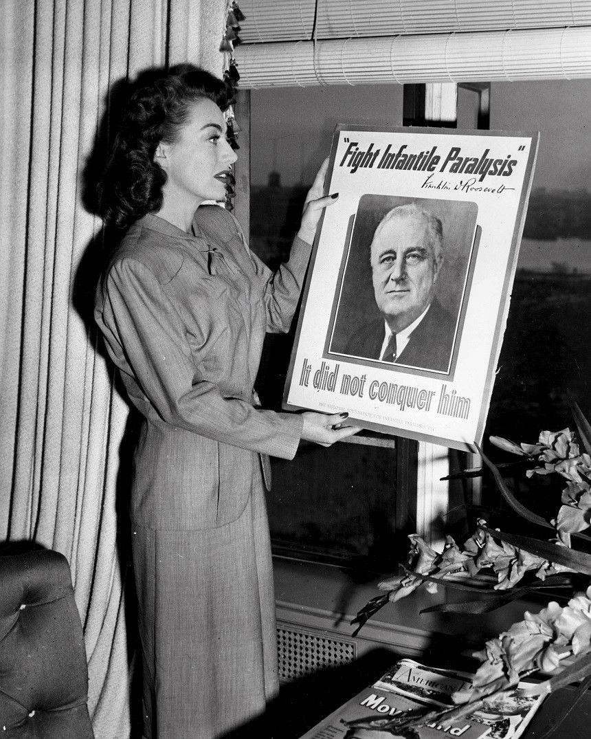 1945. With a March of Dimes poster featuring FDR.