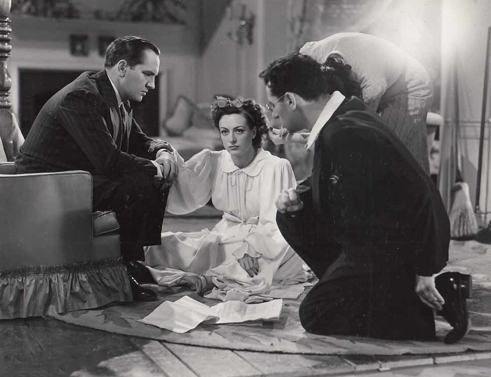1940. On the set of 'Susan and God' with director Cukor and Fredric March.
