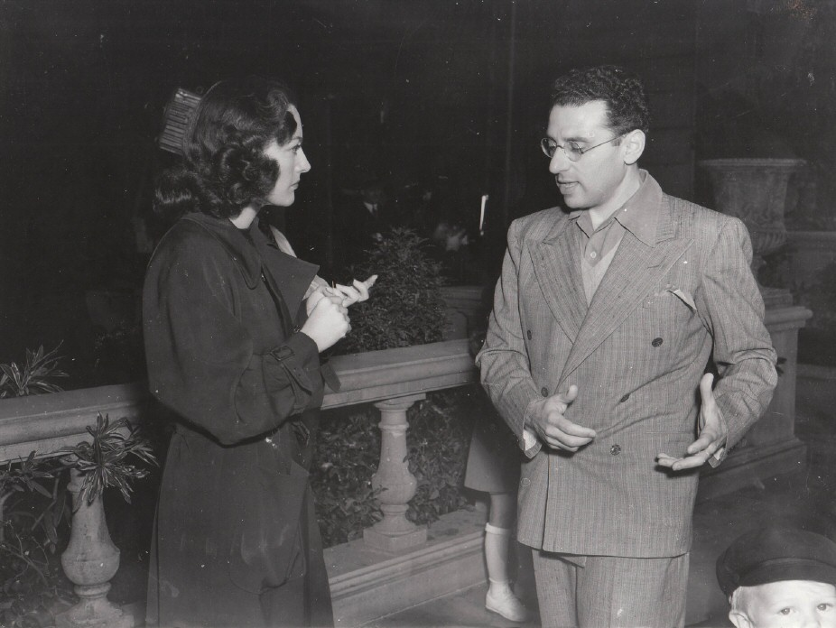 February 14, 1941. On the set of 'Woman's Face' with director George Cukor.