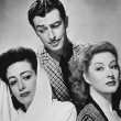 With Robert Taylor and Greer Garson.