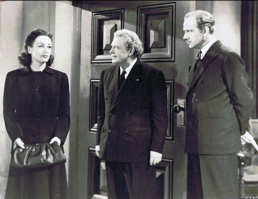 1941. 'A Woman's Face.' With Melvyn Douglas, right.