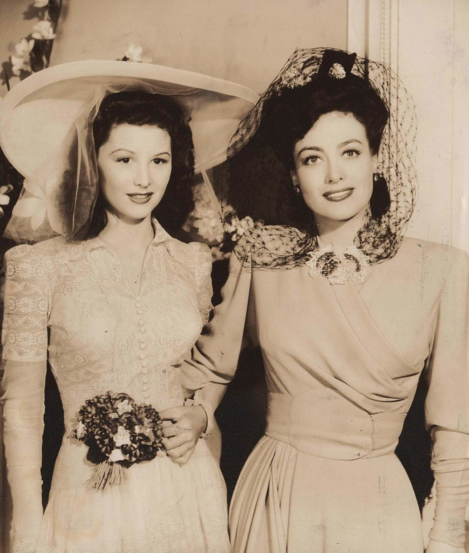 1942. On the set of 'They All Kissed the Bride.' With Shirley Patterson.