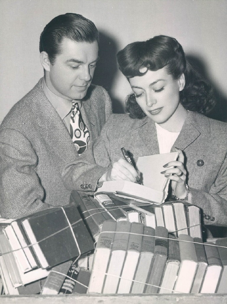 1943 at an MGM book drive, with husband Phillip Terry.